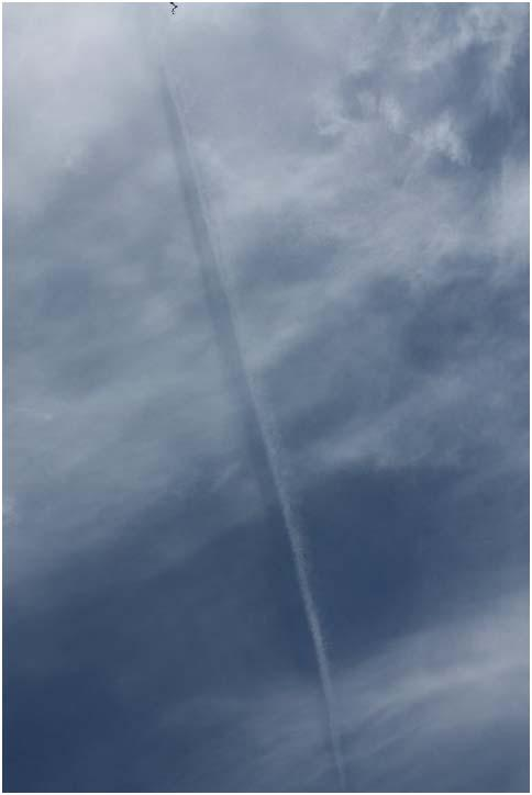 Contrail and Shadow over Devon England